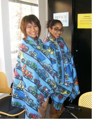Image of volunteers hugging blankets