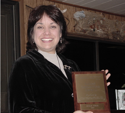 Susan Finch holding Good Samaratin 2003 Award